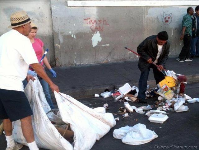 ...and more piles of garbage left by people coming here to pass out food but do not stay to help clean up the mess