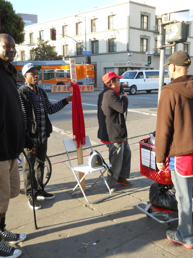 """5th & San Pedro on New Year's Eve day- the sond this gentleman was singing was """"Amazing Grace""""- some in the crown joined in and all had beautiful voices"""