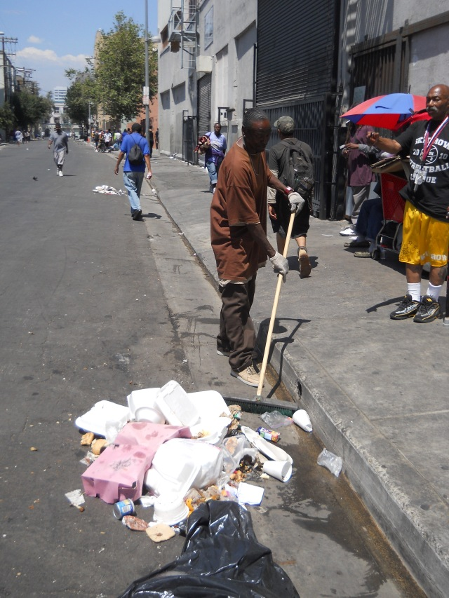 Random acts of sweeping the street @ the northeast corner of San Julian & 6th St