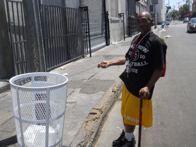 """""""OG Man"""" next to a new City trash can @ the northeast corner of 6th & San Julian St."""