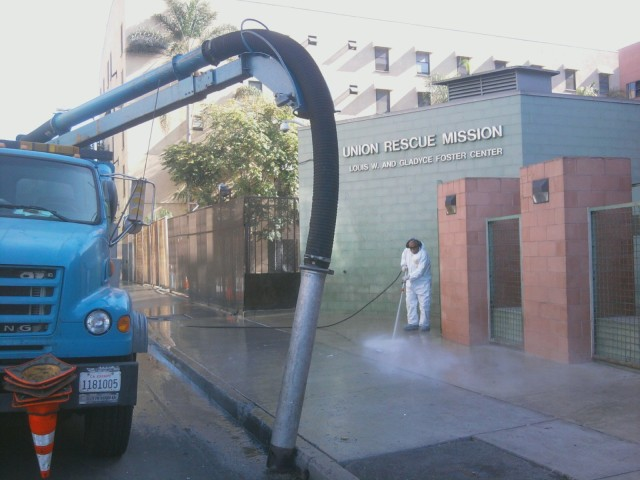 Here is the Vactor 2100 Series truck, that sucks rats and debris from the gutters of the City of Los Angeles- here it is sucking the storm drains on San Julian Street last week