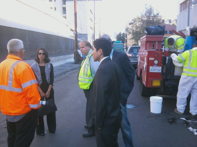 Miguel Vargas and Sara Hernedez of CD14 meeting with Operation Healthy Streets staff on San Julian Street last week